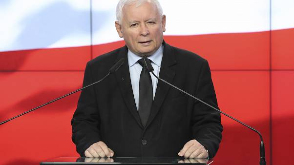 The leader of the Polish ruling party, Jaroslaw Kaczynski,center, speaks to reporters in Warsaw, Poland, Saturday, Sept. 26, 2020.