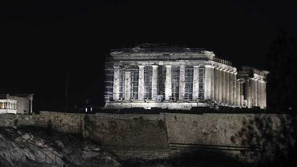 A new lighting system illuminates the ancient Acropolis hill in Athens, Wednesday, Sept. 30, 2020.