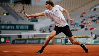 Germany's Alexander Zverev plays a shot against France's Pierre-Hugues Herbert in the second round match of the French Open in Paris, France, Sept. 30, 2020.