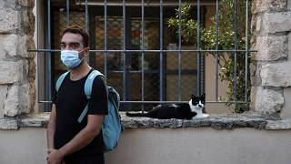 Actor and theater director Aris Laskos poses outside the Theater of Neos Kosmos in Athens, Thursday, Oct. 1, 2020.