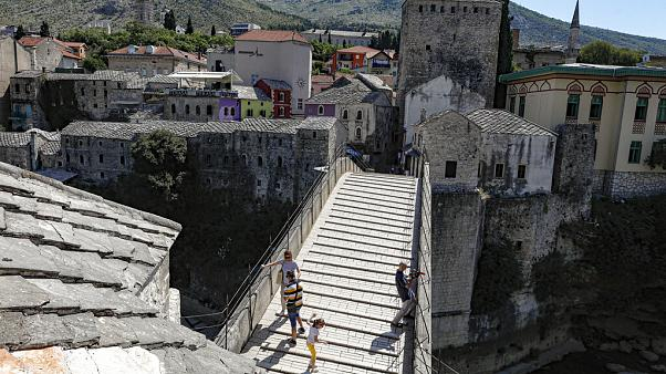 The Old Bridge in Mostar, one of Bosnia's best known landmarks, usually bustling with tourists this time of the year, is all but deserted, Thursday, July 2, 2020.