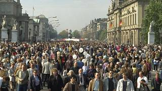 October 3, 1990, file photo, Germans stroll along the famous Unter den Linden boulevard in former East Berlin, to enjoy unification day.