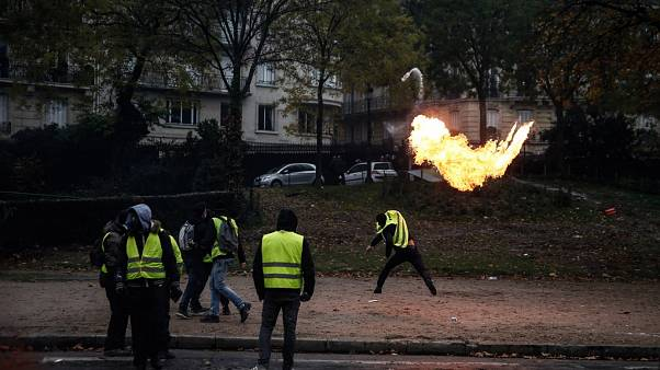 "FILE - A protester throws a molotov cocktail during a ""Yellow Vest"" protest on December 1, 2018 in Paris."