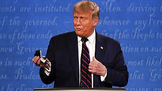 US President Donald Trump holds up a mask at the first presidential debate days before testing positive for COVID-19.