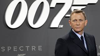 "This is a Wednesday, Oct. 28, 2015 file photo of actor Daniel Craig poses for the media as he arrives for the German premiere of the James Bond movie ""Spectre"" in Berlin"