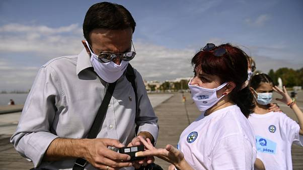 A participant has her oxygen saturation measured, during an event organized by the local medical association, in order to support the use of protective masks, in Greece.