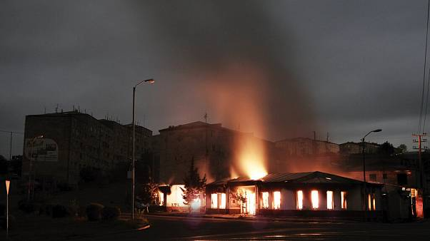 A building of a residential area burns after night shelling by Azerbaijan's artillery during a military conflict in self-proclaimed Republic of Nagorno-Karabakh, Stepanakert.