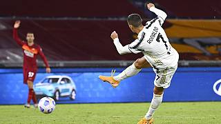 Juventus' Cristiano Ronaldo, right, takes a shot during the Italian Serie A match between Roma and Juventus at Rome's Olympic stadium, Sunday, Sept. 27, 2020.