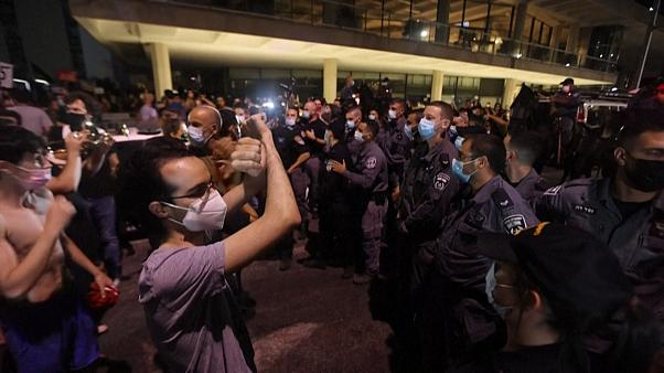 Israeli anti-government protesters blocked by the police during a demonstration