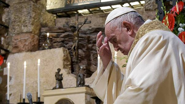 Pope Francis celebrates Mass in the crypt of the Basilica of St. Francis, in Assisi, Italy, Saturday, Oct. 3, 2020.