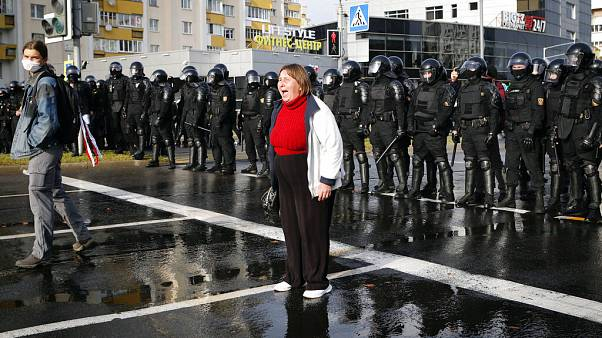 A protester shouts in front of a riot police line during a rally in Minsk, Belarus, Sunday, Oct. 4, 2020.