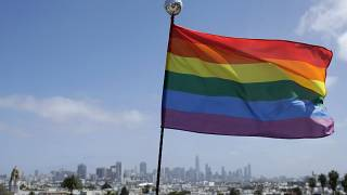 A rainbow flag flies over the skyline at Dolores Park in San Francisco, June 28, 2020.