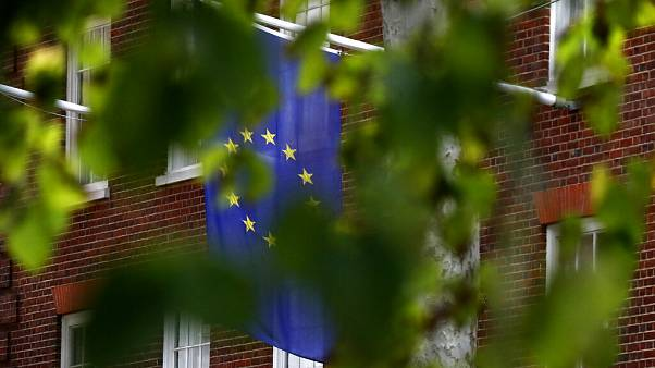 The EU flag hangs from Europa House in London, Tuesday, Sept. 29, 2020.
