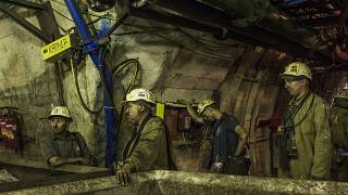End of work for the group of miners who are waiting for an elevator to go back to the surface after their work shift. Ornantowice, Poland