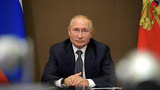 Russian President Vladimir Putin attends a meeting with Moldova's President Igor Dodon via video conference on September 28, 2020.