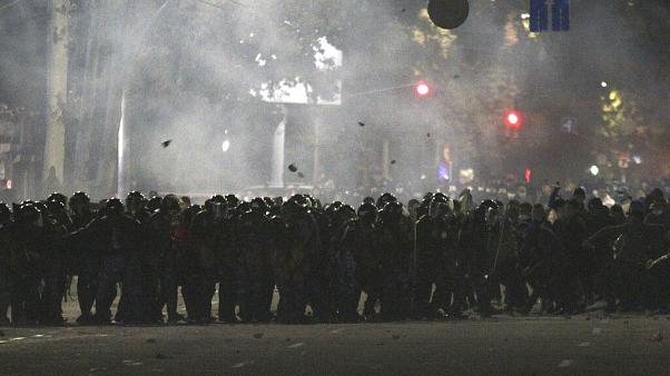 Riot police move to disperse protesters during a rally against the results of a parliamentary vote in Bishkek, Kyrgyzstan, Monday, Oct. 5, 2020.