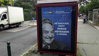 """he July 5, 2017 file photo shows an anti-Soros campaign reading """"99 percent reject illegal migration"""" and """"Let's not allow Soros to have the last laugh"""" in Budapest, Hungary."""