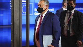 Hungary's Prime Minister Viktor Orban departs an EU summit at the European Council building in Brussels.