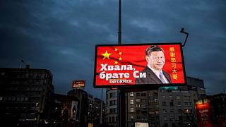 "A picture taken on March 30, 2020, shows a billboard bearing Chinese President Xi Jinping's face looking down over a boulevard next to the words ""Thank you brother Xi"""
