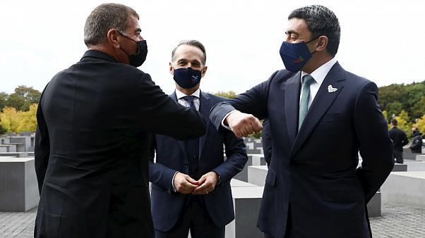 Israel Gabi Ashkenazi, left, and the United Arab Emirates Sheikh Abdullah bin Zayed Al Nahyan the Holocaust Memorial during a meeting in Berlin, Germany, Tuesday, Oct. 6, 2020
