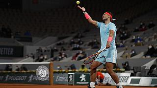 Spain's Rafael Nadal plays a shot against Italy's Jannik Sinner in the quarterfinal match of the French Open tennis tournament at the Roland Garros stadium in Paris.