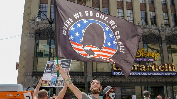 Demonstrators from conspiracy theorist group QAnon protest in Los Angeles in August.