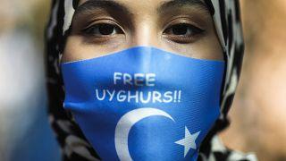من احتجاجات تطالب بحماية الإيغور