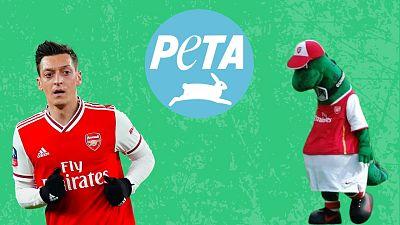 Footballer Mesut Ozil (left) is fighting PETA in the race to sign Gunnersaurus.