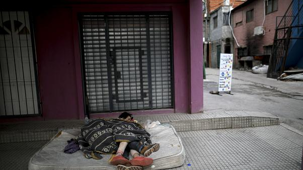 Homeless women sleep outside during a government-ordered lockdown to curb the spread of COVID-19 in Buenos Aires, Argentina on May 6, 2020