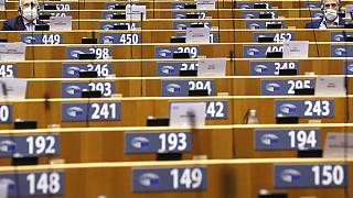 MEPs, wearing face masks to fight against the spread of the coronavirus, attend a plenary session at the European Parliament in Brussels