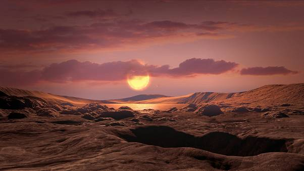 file photo - This artist's concept shows exoplanet Kepler-1649c orbiting around its host red dwarf star.