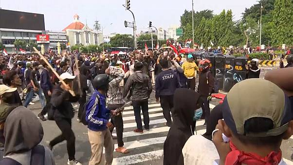 Protesters in a scuffle with police in the street