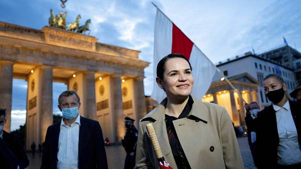 Belarusian opposition leader Svetlana Tikhanovskaya is welcomed by supporters, during a rally, by the Brandenburg Gate in Berlin.