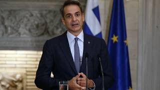 A viral photo showed Greek Prime Minister Kyriakos Mitsotakis posing without a mask alongside five motorcyclists during a mountain bike.