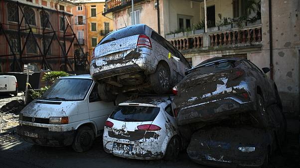 Cars stacked on top of each other by clean up crews are pictured in Breil-sur-Roya, near the border with Italy. October 5, 2020