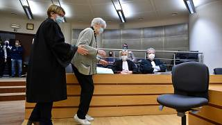 Clara Maes, 89, is helped to her seat in the courtroom where she was found guilty of murder