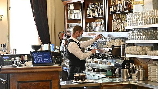 A waiter prepares coffee at cafe Einstein in Berlin, May 15, 2020.