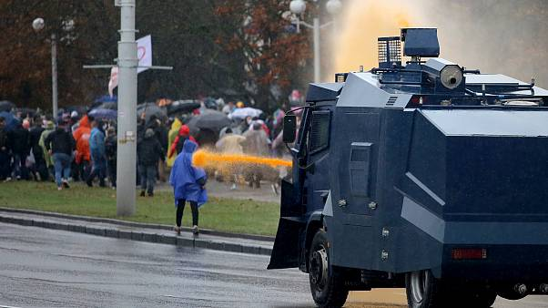 Police use a water cannon truck to disperse demonstrators during a rally to protest against the Belarus presidential election results in Minsk on October 11, 2020.