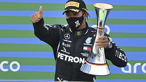 Mercedes driver Lewis Hamilton of Britain holds the trophy after winning the Eifel Formula One Grand Prix in Nuerburg, Germany, Sunday, Oct. 11, 2020.