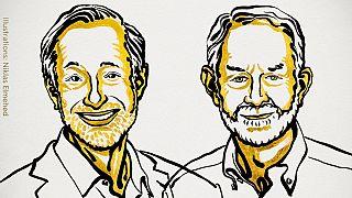 Retrato de los ganadores Paul R. Migrom (izda) y Robert B. Wilson (dcha)