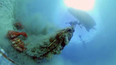 Divers lifting a ghost net in Artatore bay on Lošinj, Croatia