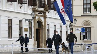 Police officers inspect the site of shooting at St. Mark's Square in Zagreb.