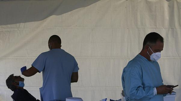 A health worker carries out COVID-19 tests of a resident of Larnaca, a resort town in southern coast of Cyprus