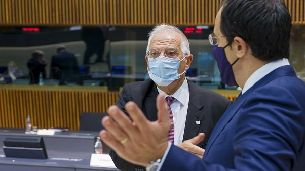 Cypriot Foreign Minister Nicos Christodoulides, right, speaks with European Union foreign policy chief Josep Borrell