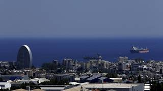 FILE - This Friday, July 6, 2018 file photo, shows the Oval building, left, one of a number of new high-rises transforming the skyline view in Limassol, Cyprus.