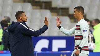 France's Kylian Mbappe and Portugal's Cristiano Ronaldo, right, greet each other at the end of the UEFA Nations League football match between France and Portugal