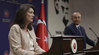 Sweden's Foreign Minister Ann Linde, right, and Turkish Foreign Minister Mevlut Cavusoglu