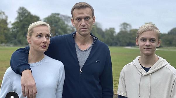 Navalny, centre, poses for a photo with his wife Yulia and their son Zahar in an unknown location in Germany.
