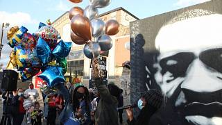 People gather at George Floyd's memorial to celebrate his birthday