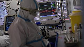 A medical monitor displays vital life signs of a patient infected with COVID-19 in one of the intensive care units at the Severo Ochoa hospital, on the outskirts of Madrid